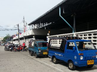 Taxi vans waiting outside Hat Yai Bus Station